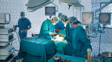 carrier-doctors-operating-in-hospital-operating-room