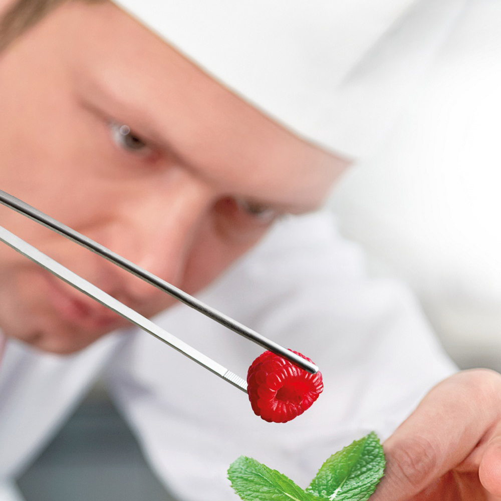 chef-placing-raspberry