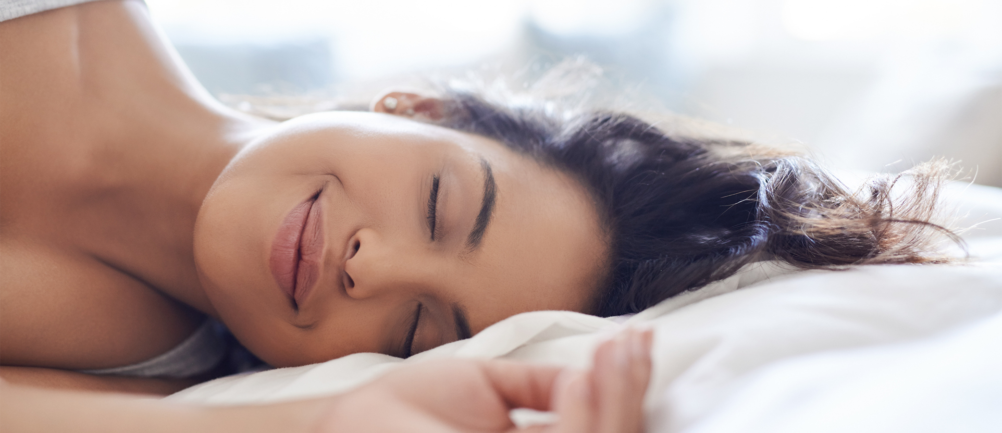 woman-enjoying-ultra-quiet-performance-while-sleeping