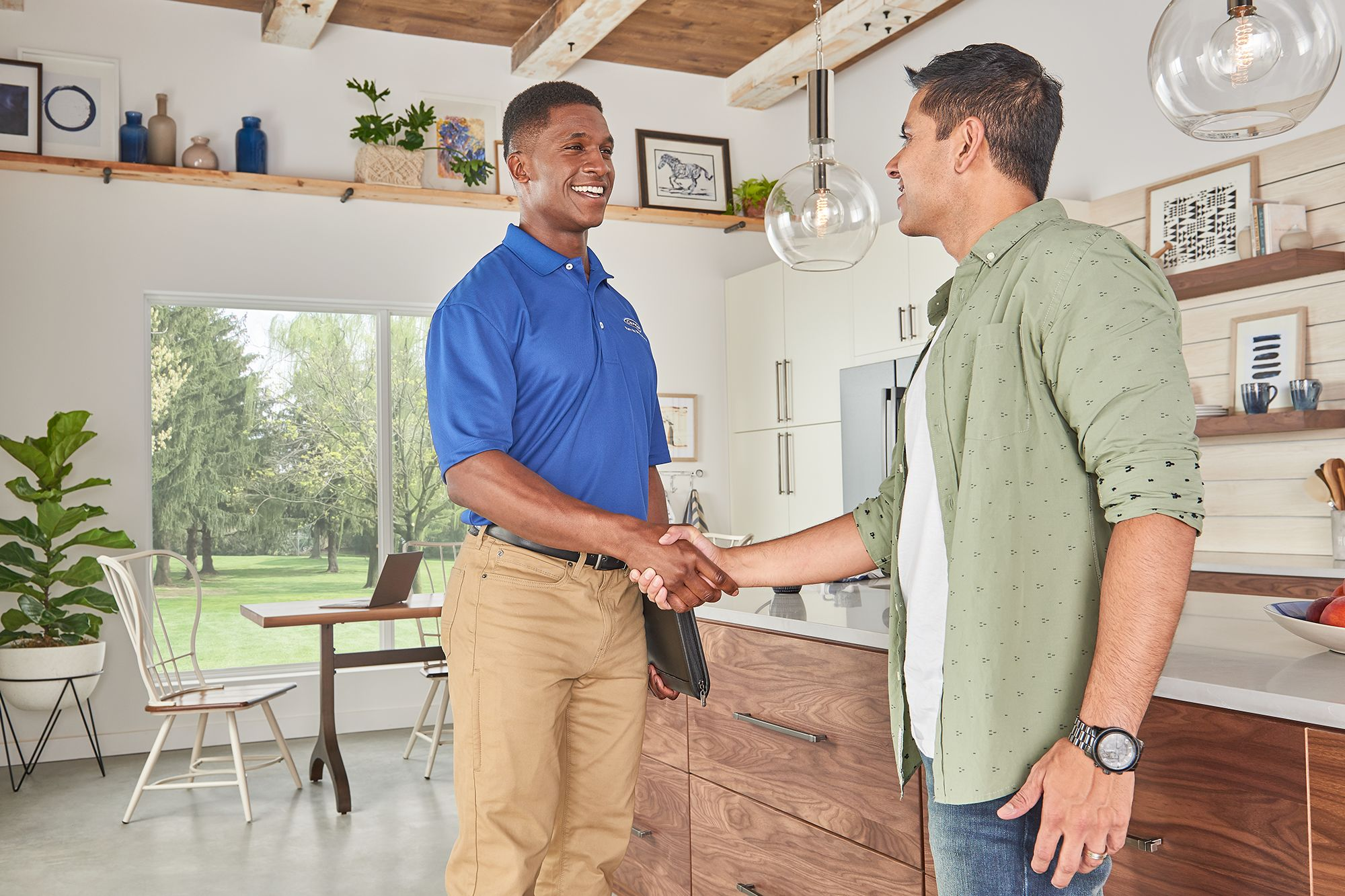 carrier-contractor-and-homeowner-handshake