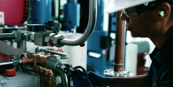 A worker assembles an HVAC component