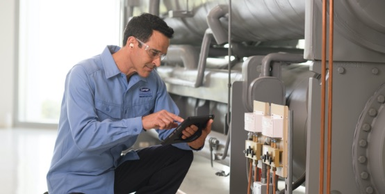 A tech checks the operation of an HVAC component