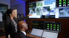Administrators monitor the various systems of a building on-screen