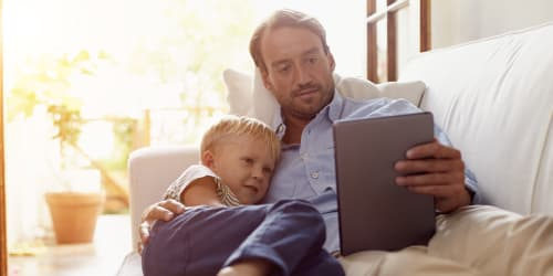 man-and-son-holding-up-tablet