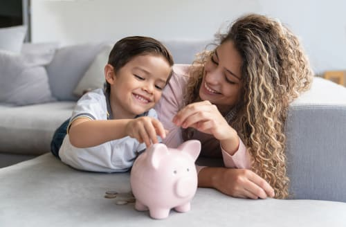 mother-and-child-with-piggy-bank
