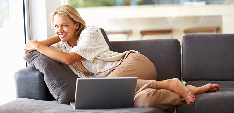 happy-woman-lounging-in-ventilated-living-room