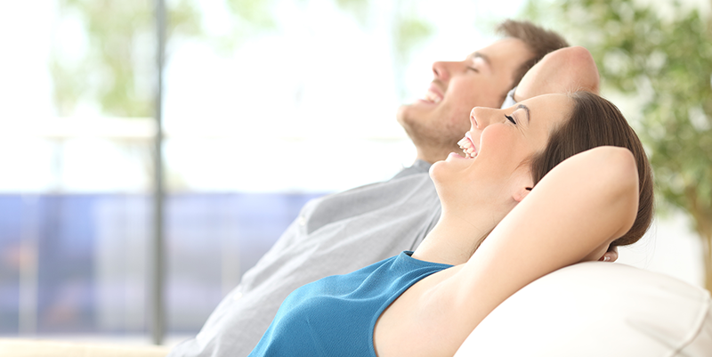 man-and-woman-enjoying-clean-indoor_air-with-UV-air-purifiers