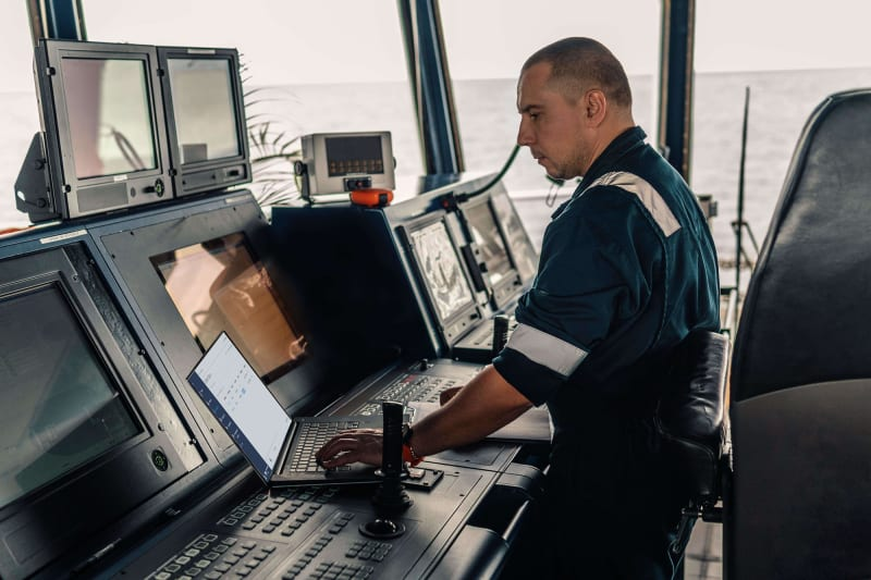 Person on ship using TripLINK to monitor containers
